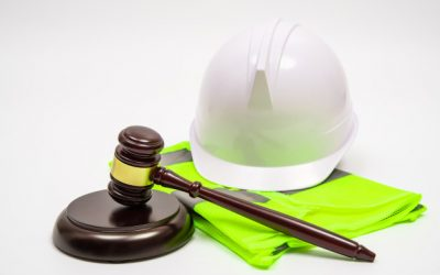 labor-related-legal-concept-with-safety-hats-work-clothes-judge-gavel-white-background_127345-264